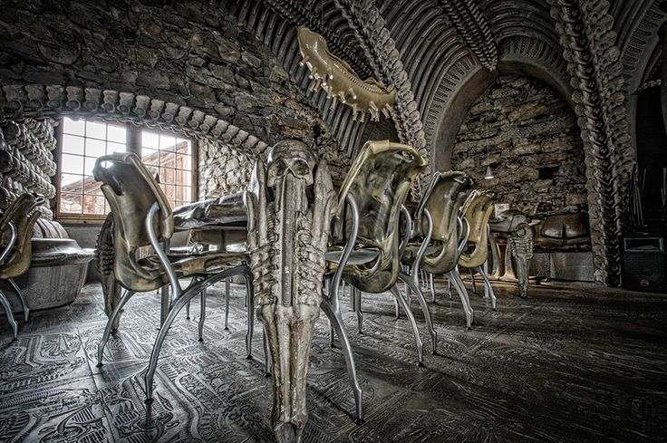 MUSEUM HR GIGER BAR in Château St. Germain, Gruyères, Switzerland -The interior of the otherworldly environment that is the H.R. Giger Museum Bar is a cavernous, skeletal structure covered by double arches of vertebrae that crisscross the vaulted ceiling of an ancient castle. The sensation of being in this extraordinary setting recalls the tale of Jonah and the whale, lending the feel of being literally in the belly of a fossilized, prehistoric beast.