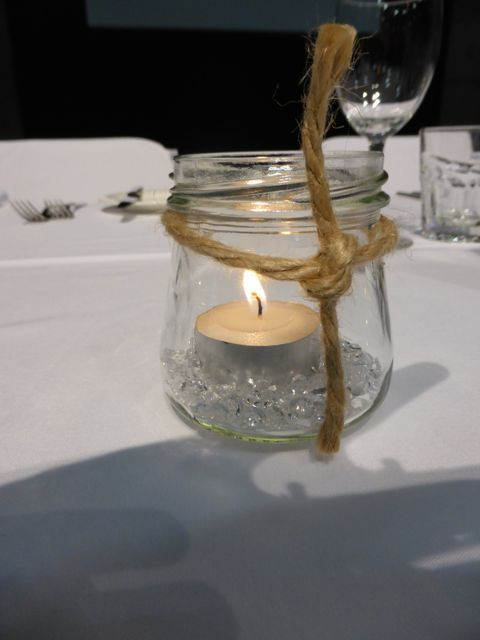 Up cycled jars, tea lights a bit of bling and twine.  Love it.  So simple for any wedding or engagement on a budget.  http://www.tailracecentre.com.au/weddings/