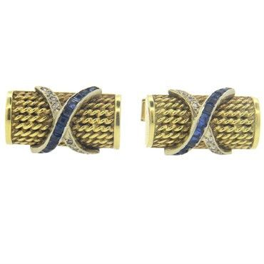 Mid Century 14k gold cufflinks, decorated with blue sapphires and diamonds DESIGNER: Not Signed MATERIAL: 14K Gold GEMSTONE: Diamond,…
