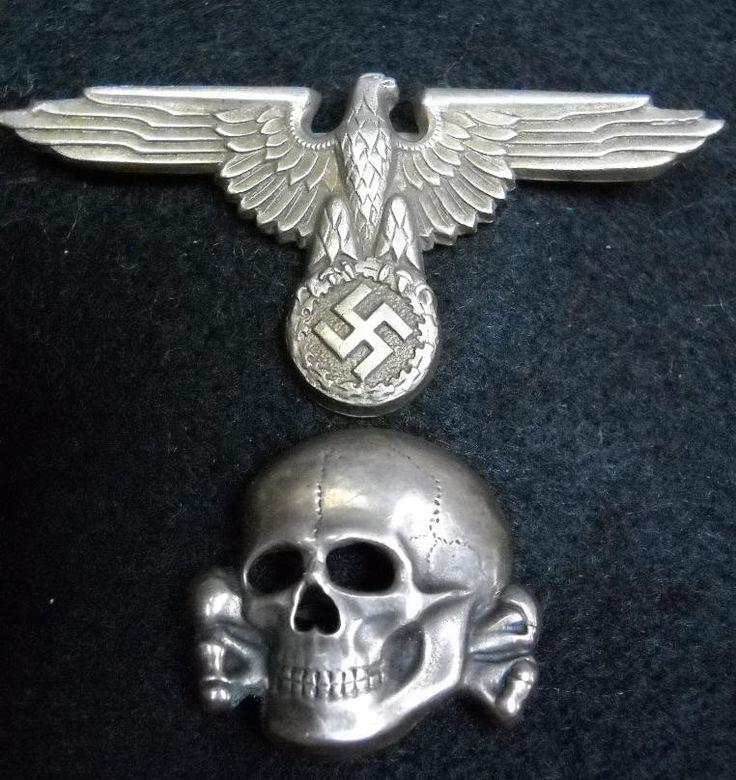 German  World War Two Waffen or Allegemine SS Metal Skull & Eagle SS Period Hat Set.