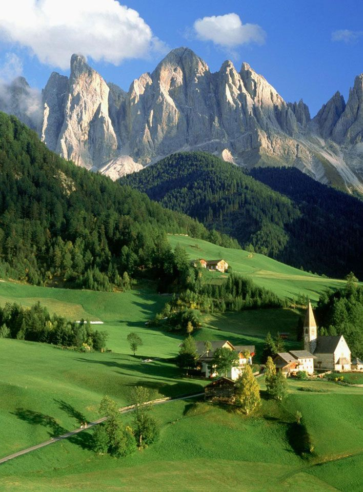 Italy. Odle mountains,  Puez Geisler Nature Park, South Tyrol. Odle, which means needles in Latin, offers spectacular vistas of meadows along with gondolas. The heart of the Odle Mountains within The Dolomites lies at the narrow mountain notch which is known as the Forcella Pana.