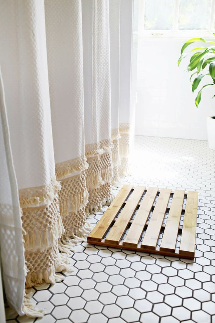 Laura from A Beautiful Mess made her bathroom look more luxe with a DIY fringed shower curtain that reaches all the way to the floor. See more: We're Loving Fringe: 8 Projects That Show How To Use It Now | Apartment Therapy