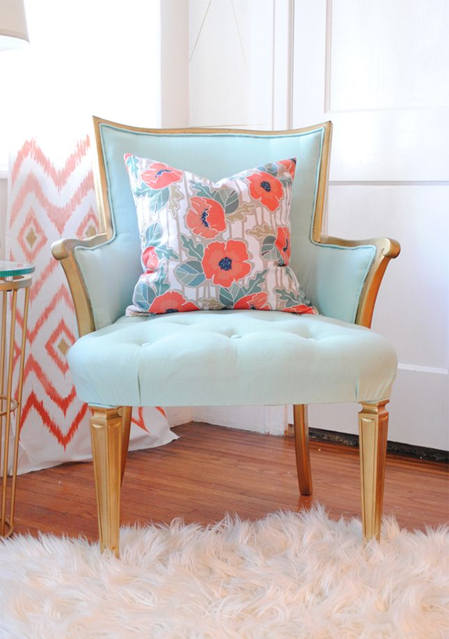 Use fabric and gold paint to upcycle an old chair.