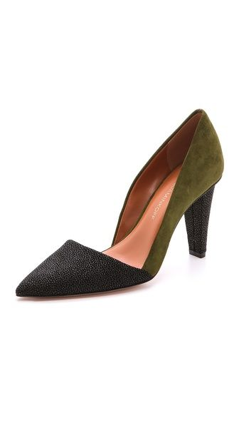 Rebecca Minkoff pumps in a cool mix of rich suede and stingray-embossed leather. Subtly asymmetrical vamp. Covered heel and leather sole.