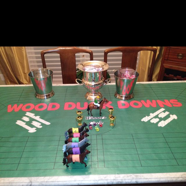 Derby Party Game, BEST EVER!! Make an oval track with lanes and spaces.  Need 6 plastic horses and 6 dice.  Number horses 1-6.  Each player antes $1 each player rolls one dice to assign horse/number.  Roll all 6 dice, the numbers on the dice that horse moves one space.  ie roll 666345 the 6 horse moves three spaces the 345 moves one. First horse cross the finish line takes the pot.  Reload replay.