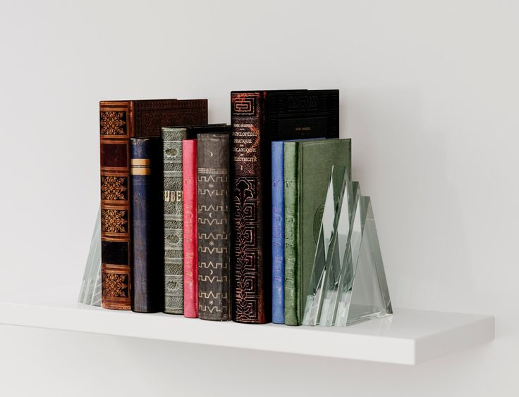 MidCentury Modern Bookends. Triangular thick glass bookends, perfect for any Art Deco or Modern living space. by MirrorCooperative on Etsy https://www.etsy.com/listing/194712755/midcentury-modern-bookends-triangular