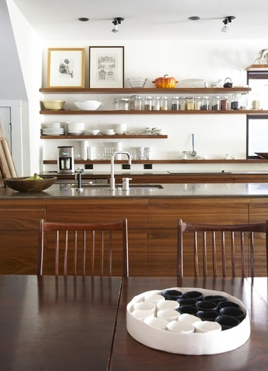 kitchn -- elegant riff on arts and crafts chairs (lighter but still man-friendly), wood grain on cabinets