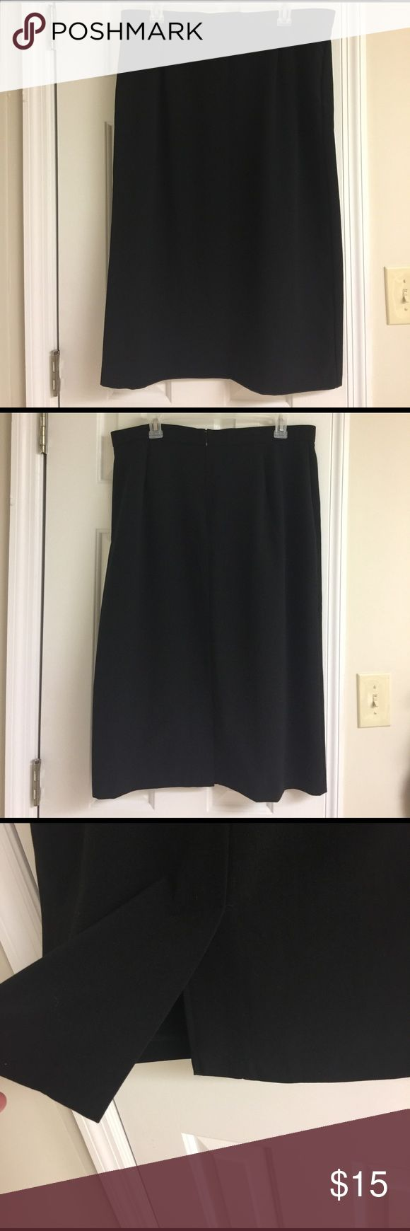 Black Calf Length Skirt Sz. 14 by Briggs New York Perfect for the office or a night on the town. Size 14 black calf length skirt by Briggs New York. Small slit at center on bottom back part of skirt. Back zipper. Briggs New York Skirts