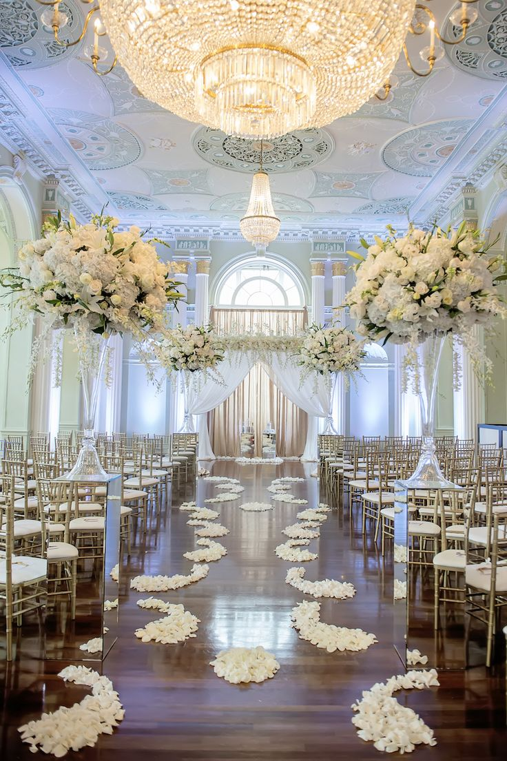 White #Flower Petal Aisle Runner - Beautiful #Bridal #Aisle Walkway  Photography: Milanés Photography Read More: http://www.insideweddings.com/weddings/white-silver-gold-wedding-at-the-biltmore-ballrooms-in-atlanta/680/