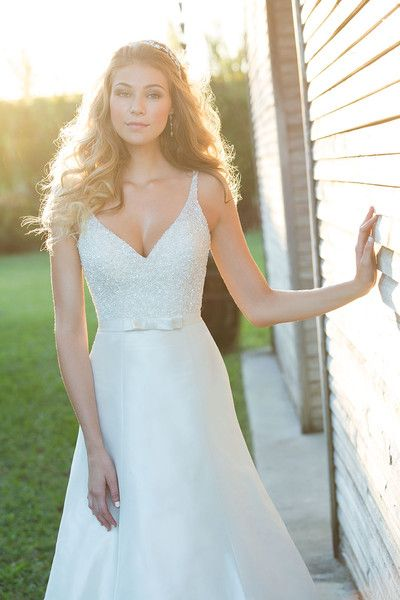 This chic Madison James satin gown features beaded straps and a sweet bow at the waist. Love.