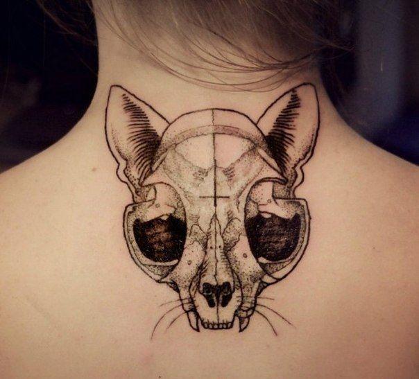 Awesome black grey cat skull tattoo on back