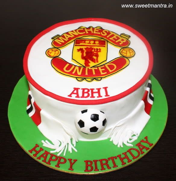 Manchester United Football theme small designer cake with MANU logo by Sweet Mantra - Customized 3D cakes Designer Wedding/Engagement cakes in Pune - http://cakesdecor.com/cakes/295857-manchester-united-football-theme-small-designer-cake-with-manu-logo