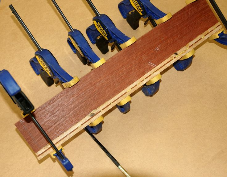 Step 5: Inlay is glued and clamped to Jarrah timber panel