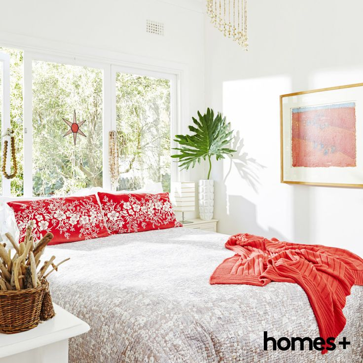 Bright #coral adds a hit of #colour to Di's restful, light-filled #bedroom. As featured in the June 2015 issue of homes+. #beach #house #readerhome