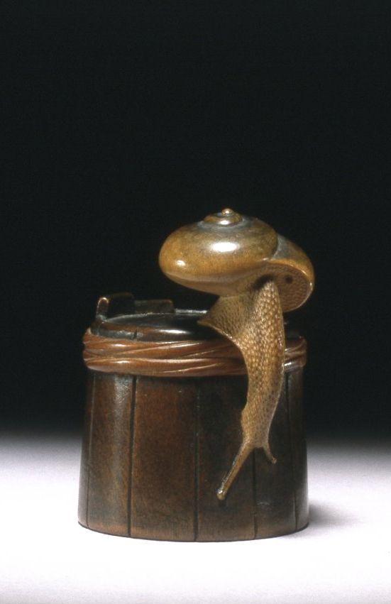 Netsuke. Snail on tub. Made of wood.. 19th century, Japan, by artist Shigemasa