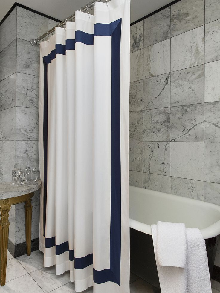 A crisp percale outlined in a bold band of color adds a bit of style to the bath.