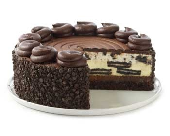 OMG!!!  The Cheesecake Factory -  Creamy Cheesecake loaded with OREO® Cookies, topped with OREO® Cream Mousse and Chocolate Icing