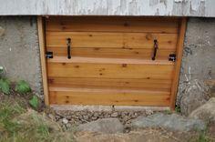 Irvin's amazing crawl space door! Simple, cedar, and beautiful too!