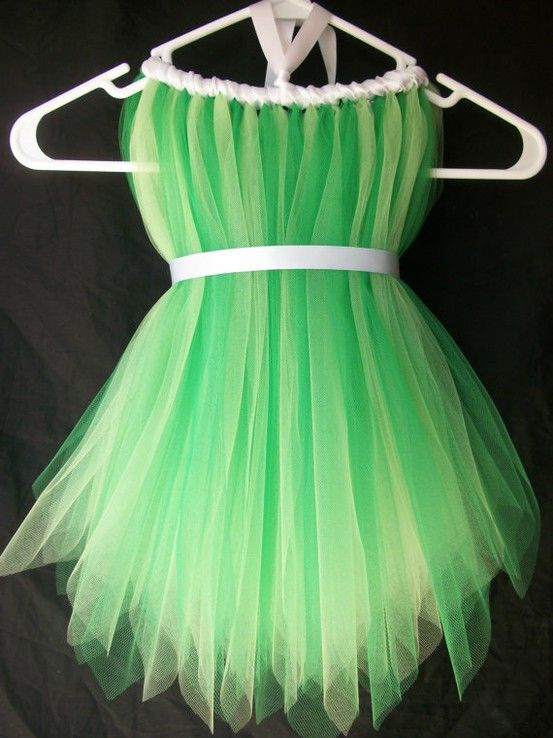 Tinkerbell costume DIY - Measure the length you need it, cut strips of tulle twice that length (maybe 2 or 3 extra inches for the knot and gathering at the waist), tie in a knot a round a length of elastic at the neckline, then wrap a ribbon around the elastic, between the tulle knots. cut another length of ribbon for the waist.