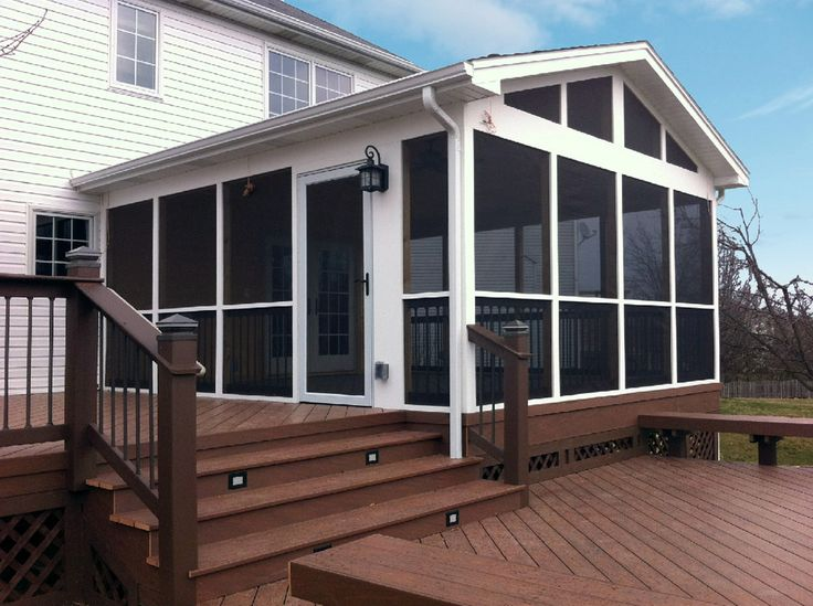 Classic White Screened Porch With Multi Level Deck