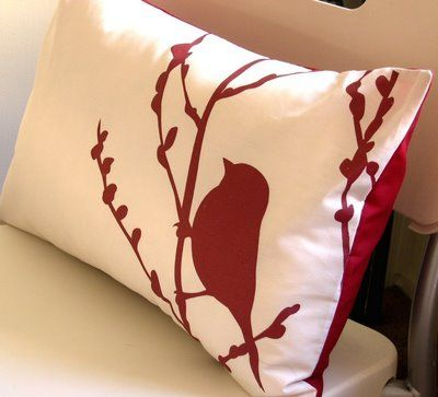 create your own unique pillow covers by cutting colored felt silhouettes into the shapes of birds or any other animal you like