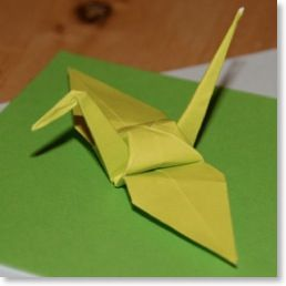 Origami Crane video Tutorial : pretty threaded in coordinated patterned & plain paper on coloured thread, hanging in windows, dangling in cars, fluttering as a mobile.