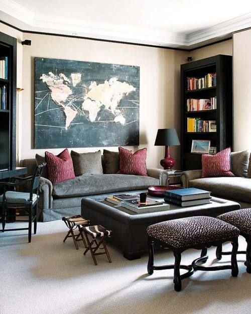 Fashionable Living Room With Leopard Print Footstools And Mixed Media Map Art Via Sapphire