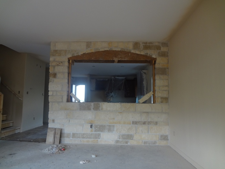 Stone Accent Wall Btween Casual Dining Room And Family