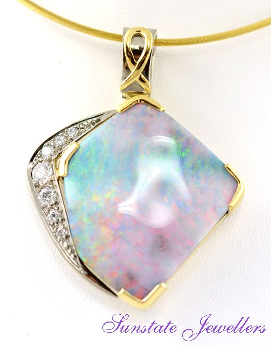 18ct yellow and white gold pendant with large 39ct boulder opal with undulating pattern and brilliant cut diamonds