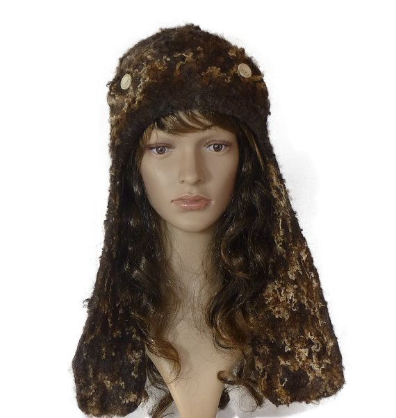 A ear flap style hat, this wonderful hat.   Handmade from 100%  wool  and BlueFace Leicester fleece.