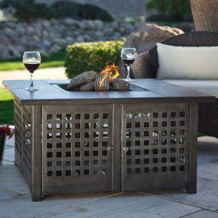 propane fueled firepit for outdoor patio.  love that there's a table for your wine
