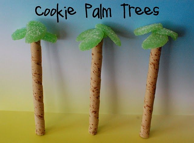 cut a green fruit slice into thirds and connect at the points with a toothpick.  Insert the toothpick into the top of a pirouette cookie.