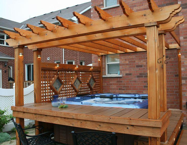 hot tub with deck, pergola