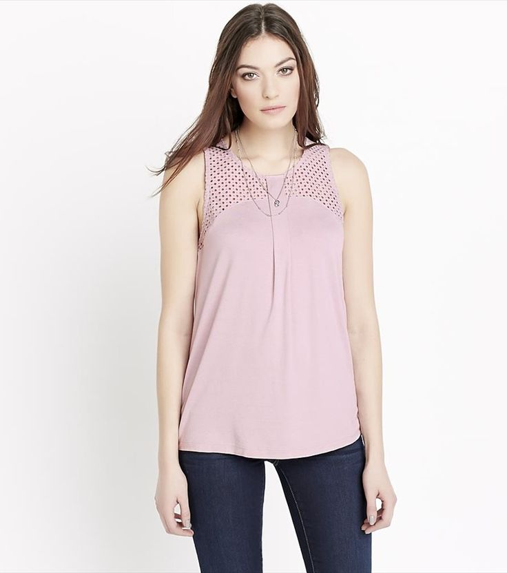 Show off a little skin in the classiest way possible with this pretty pink tank.