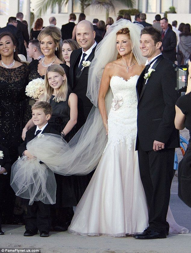 Mother's protector: As the wedding party posed for pictures, adorable little Kayden held his mother's veil