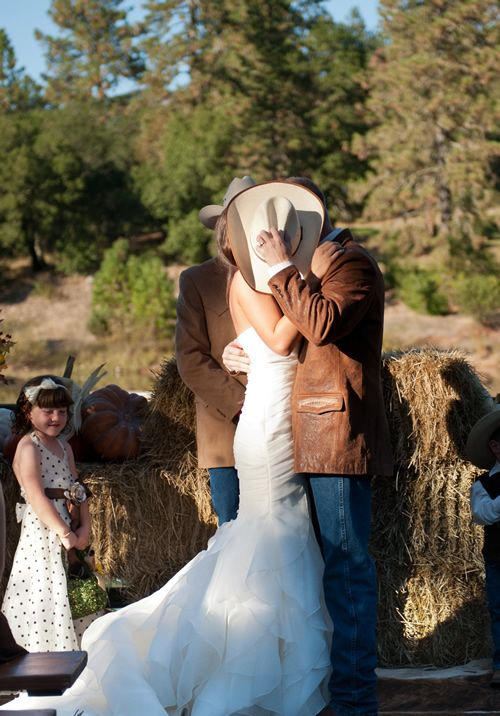 "Very themed, but the hat covering up the kiss is super cute! Maybe engagement shots...... ""A Cowgirl Wedding at Atwood Ranch » Tia & Claire Studio Blog"""