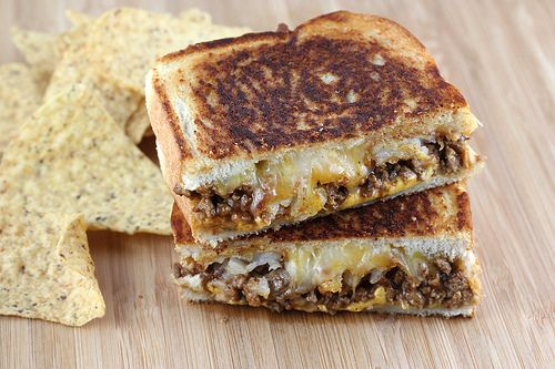 Taco Grilled Cheese .. two different types of cheeses; American and Mexican cheese blend. The sandwich is also topped with taco meat and potato crowns.