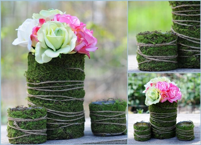 fill clear cylinder with moss and battery light strand inside with twine wrapped around outside of vase.
