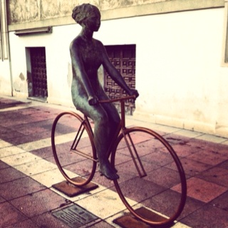woman on bicycle statue