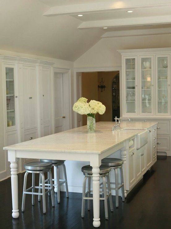 amazing Kitchen Island With End Seating #5: kitchen table integrated into island, white cabinets, stainless hardware,  marble counter tops.