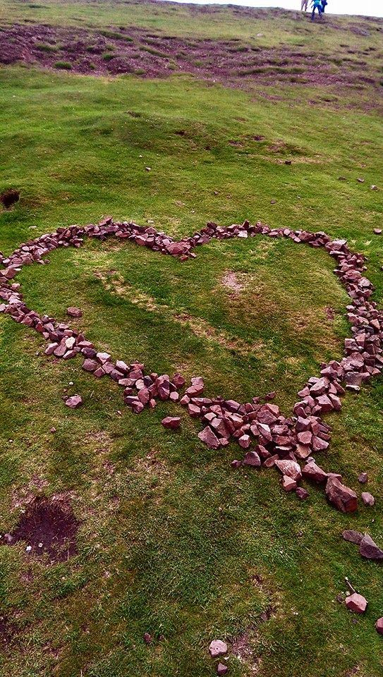 Stone drawings and messages decorate the top of Arthur's Seat!