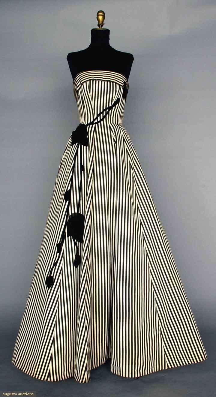 BLACK & WHITE BALLGOWN, 1950s. Silk faille in black & white stripes, strapless, princess seams, full skirt, black velvet & chiffon trailing rose trim. Front