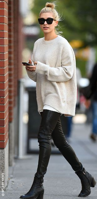oversized sweaters, black leggings & black booties make for a sleek street fall look