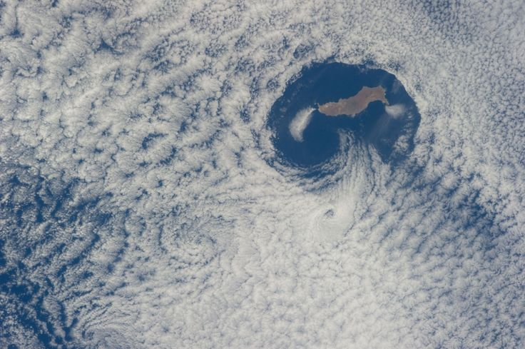 Guadalupe Island and Von Karman Cloud Vortices - From an altitude of 223 nautical miles, one of the Expedition 40 crew members on the International Space Station photographed this nearly vertical image of Guadalupe Island and the Von Karman cloud vortices that are its storied neighbors just off southern California's Pacific Coast. Credit: NASA | redOrbit.com