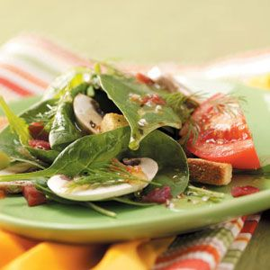 Italian Spinach Salad Recipe:  Here's a quick, colorful veggie salad as refreshing as springtime itself. It's also pretty as a picture and a great way to use up all those extra hard-cooked Easter eggs! —Gloria Warczak, Cedarburg, Wisconsin