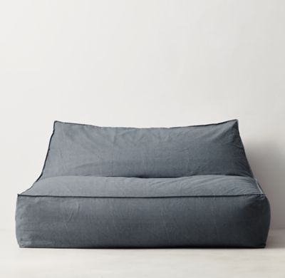 RH TEEN's Distressed Canvas Wide Bean Bag Lounger:Version 2.0. Our relaxed lounger is a new take on the classic bean bag silhouette with its raised back and roomy seat. Covered in machine-washable canvas, it's filled with a body-conforming bead insert that cradles you in comfort.