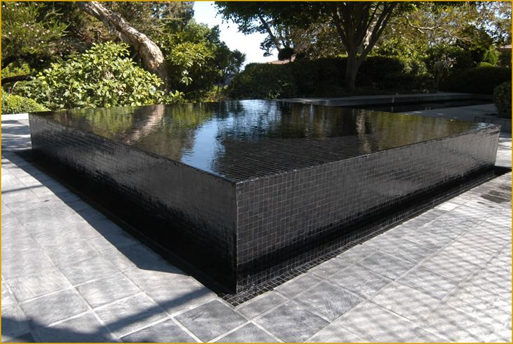 a bit too 70s modern for my tastes but nice reflecting pool effect black glass tile spa by skip phillips pools pinterest nice uxui designer and