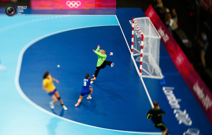 France's Blandine Dancette scores a goal on Sweden's goalkeeper Gabriella Kain in their women's handball Preliminaries Group B match at the Copper Box venue during the London 2012 Olympic Games. MARKO DJURICA/REUTERS
