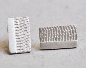 Rectangular sterling silver stud earrings.