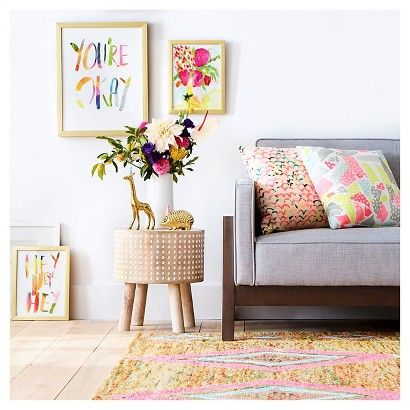 Give your room a focal point and add fun elements with throw pillows, wall art, figurines and sculptural furniture in the Living Room Collection Featuring Oh Joy! Pillows with pastels, prints in citrusy colors, and the shine of gold dazzle the eye.